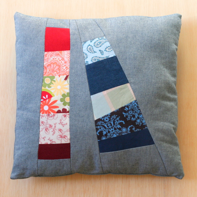 Finished denim patchwork pillow