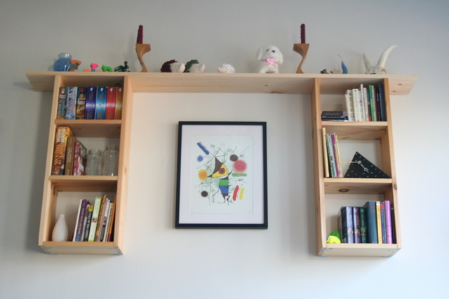 finished wooden wall-hung bookshelf
